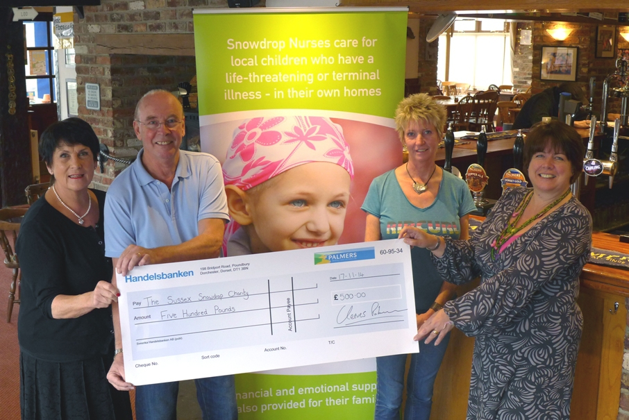 The Sussex Snowdrop Trust receives a cheque for £500 from the Palmers Ale Fund